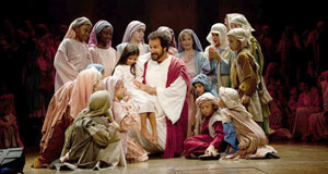 Pictured: Actors portray Christ and children.