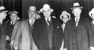 Pictured: Al Capone being escorted to the train in Chicago that will take him to U. S. Federal Penitentiary in Atlanta.