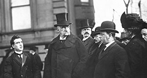 Pictured: John Pierpont Morgan (center), surrounded by a group of men.