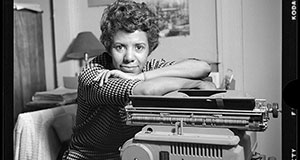 Pictured: Lorraine Hansberry leans over her typewriter in her Greenwich Village apartment on Bleecker Street during her April 1959 photoshoot for Vogue.