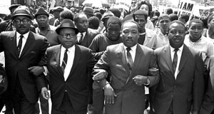 Pictured: The Rev. Ralph Abernathy, right, and Bishop Julian Smith, left, flank Dr. Martin Luther King, Jr., during a civil rights march in Memphis, Tenn., March 28, 1968.