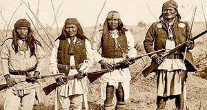 Pictured: Vintage photo of Native American Warriors with guns.