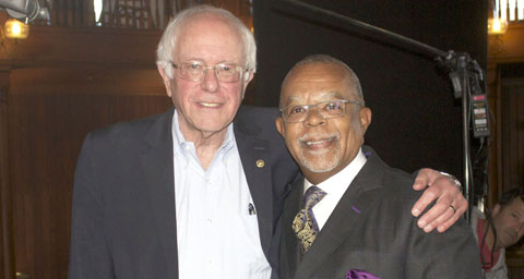 Pictured: Henry Louis Gates, Jr. with Bernie Sanders on the set of FINDING YOUR ROOTS.