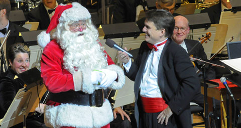 Pictured: Santa Claus with Boston Pops conductor Keith Lockhart at the opening night of Holiday Pops.