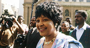 Pictured: Winnie Mandela during her trial in Johannesburg for the murder of child activist Stompie Sepei (1992).