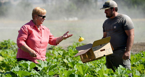 Pictured: Host Lidia Bastianich picks patty pan squash with Army veteran Matt Smiley of the Farmer Veteran Coalition.