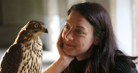Pictured: Helen Macdonald with goshawk at Jesus College, Cambridge, England.